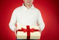 Man with christmas gift image of male in white pullover holding red giftbox Royalty Free Stock Image