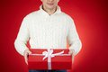Man with christmas gift image of smiling male holding red giftbox Royalty Free Stock Photos
