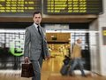 Man classic grey suit briefcase airport Royalty Free Stock Photo