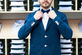 Man in classic suit against showcase with shirts handsome young Royalty Free Stock Image