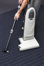 Man is cleaning the carpet vacuum cleaner Stock Photography