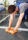 Man cleaning with duster young the dust on floor Royalty Free Stock Photography