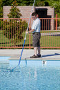 Man cleaning a pool Stock Photo
