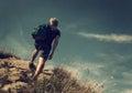 Man climb on mountain hill Stock Photos