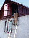 Man climb the stairs in attic in romanian country house Royalty Free Stock Photo