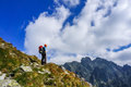 Man climber with helmet admiring the view from edge of a cliff in mountains high tatra slovakia Stock Photos