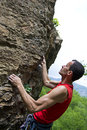 Man climbing on granite Royalty Free Stock Images