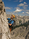 A man climbing in mountains Stock Image