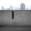 Man climbing over wall with business doodles Royalty Free Stock Photo
