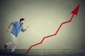 Man climbs running up career ladder graph