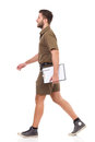 Man with clipboard walking Royalty Free Stock Photo