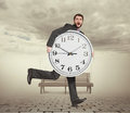 Man with clock in foggy park startled holding big and running Royalty Free Stock Photos