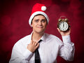 Man with clock handsome studio shot Royalty Free Stock Photography