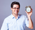 Man with clock holding big studio Royalty Free Stock Photo