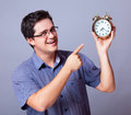 Man with clock holding big studio Stock Image