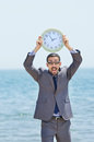 Man with clock on seaside Royalty Free Stock Photo