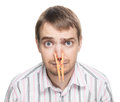 Man with clothespin on his nose portrait of caucasian orange bad smell concept photography Royalty Free Stock Photos