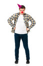 Man with clown nose young in shirt red and birthday cap isolated on white background Royalty Free Stock Photography