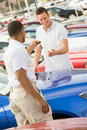 Man collecting new car Royalty Free Stock Photo