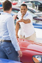 Man collecting new car from salesman Royalty Free Stock Photo