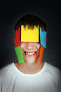 Man with Colored Paper on Face Royalty Free Stock Image