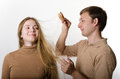 Man is combing his girlfriend's hair Stock Photos