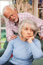 Man comforting senior woman with depression husband comforts suffering from Stock Image