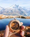 Man with compass in hand Royalty Free Stock Photo