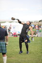 Man competes in weight toss gets air event at the rio grande valley celtic festival albuquerque new mexico Stock Photography