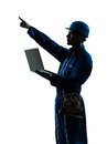 Man construction worker computing computer silhouette portrait one caucasian in studio on white background Royalty Free Stock Photo