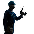 Man construction worker holding drill silhouette Stock Photography