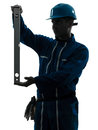 Man construction worker holding level silhouette Royalty Free Stock Photography