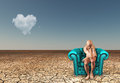 Man contemplates in desert with heart shaped cloud Stock Image