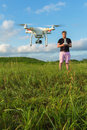 Man controlling drone single in pink pants outdoors Royalty Free Stock Photos