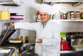 Man cook making kebab dish on kitchen in fast food restaurant Royalty Free Stock Photo