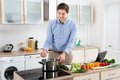 Man Cooking Food In Kitchen Royalty Free Stock Photo