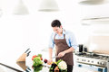Man cooking food in minimalist kitchen Royalty Free Stock Photo
