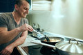 Man cooking at home alone Royalty Free Stock Photo