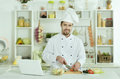 Man cooking in kitchen Royalty Free Stock Photo