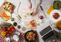 Man cooking with laptop Royalty Free Stock Photo