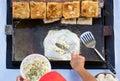 Man cooking Martabak or Stuffed Pancake