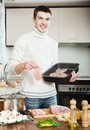 Man cooking  meat Royalty Free Stock Photography