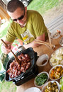 Man cooking outdoors Royalty Free Stock Photo