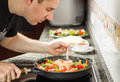 Man cooking vegetables and chicken in a pan handsome for mexican food black Stock Image