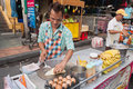 Man cooks thai banana pancake on the street bangkok thailand dec khaosan road dec in bangkok thailand khaosan road or khao sarn Stock Photos