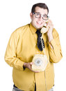 Man with corded phone a an old fashioned taking a call Stock Photos