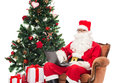 Man in costume of santa claus with laptop Royalty Free Stock Photo