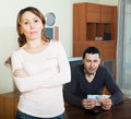 Man counting currency woman watching him financial problems in family women in home Royalty Free Stock Image