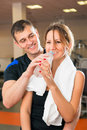 Man courting a woman during a workout women at the gym Royalty Free Stock Photos