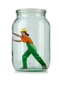 Man in coveralls imprisoned glass jar Royalty Free Stock Photos